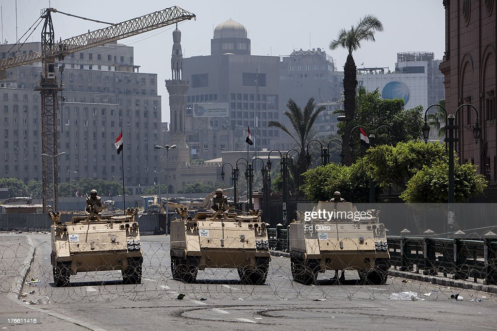 Egyptian military armored vehicles stand guard at a checkpoint on the edge of Tahrir Square by the Egyptian Museum on August 16, 2013 in Cairo, Egypt. The Egyptian Military has closed off the city's iconic Tahrir Square today to pedestrian traffic in response to calls for mass protests in downtown Cairo by supporters of deposed Egyptian President Mohammed Morsi after midday prayer. Hundreds of pro-Morsi protesters were killed in Egypt's capital on August 14 as Egyptian Security Forces undertook a planned operation to clear Morsi supporters from two sit-in demonstrations in Cairo where they have camped for over one month. Egyptian Police and Army forces entered protest sites in the Nasr City and Giza districts at dawn on August 14, using tear gas, live fire and bulldozers to disperse protesters and destroy the camps.