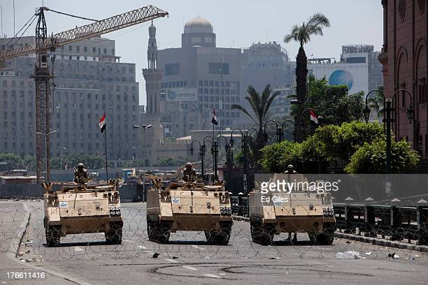 Egyptian military armored vehicles stand guard at a checkpoint on the edge of Tahrir Square by the Egyptian Museum on August 16 2013 in Cairo Egypt...