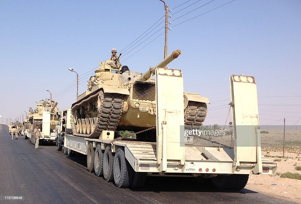 Egyptian military tanks are deployed in the northern Sinai town of Al-Arish on July 16, 2013. With an insurgency threatening its sensitive border with Israel, Egypt's military is preparing to go on the offensive against Sinai militants who have escalated attacks since president Mohamed Morsi's ouster.