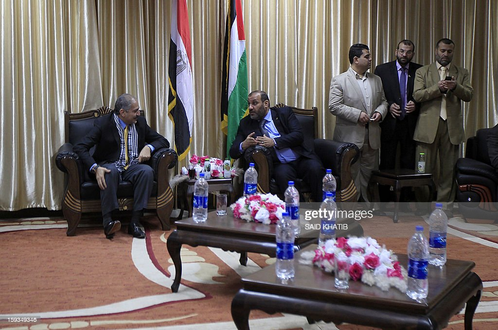 Egyptian Minister of Sports Elamri Faruq (L) meets with Minister of Youth, Sports and Culture in Gaza Mohammed Almadhun, upon his arrival in the southern Gaza Strip town of Rafah through the border with Egypt, on January 12, 2013. AFP PHOTO/ SAID KHATIB