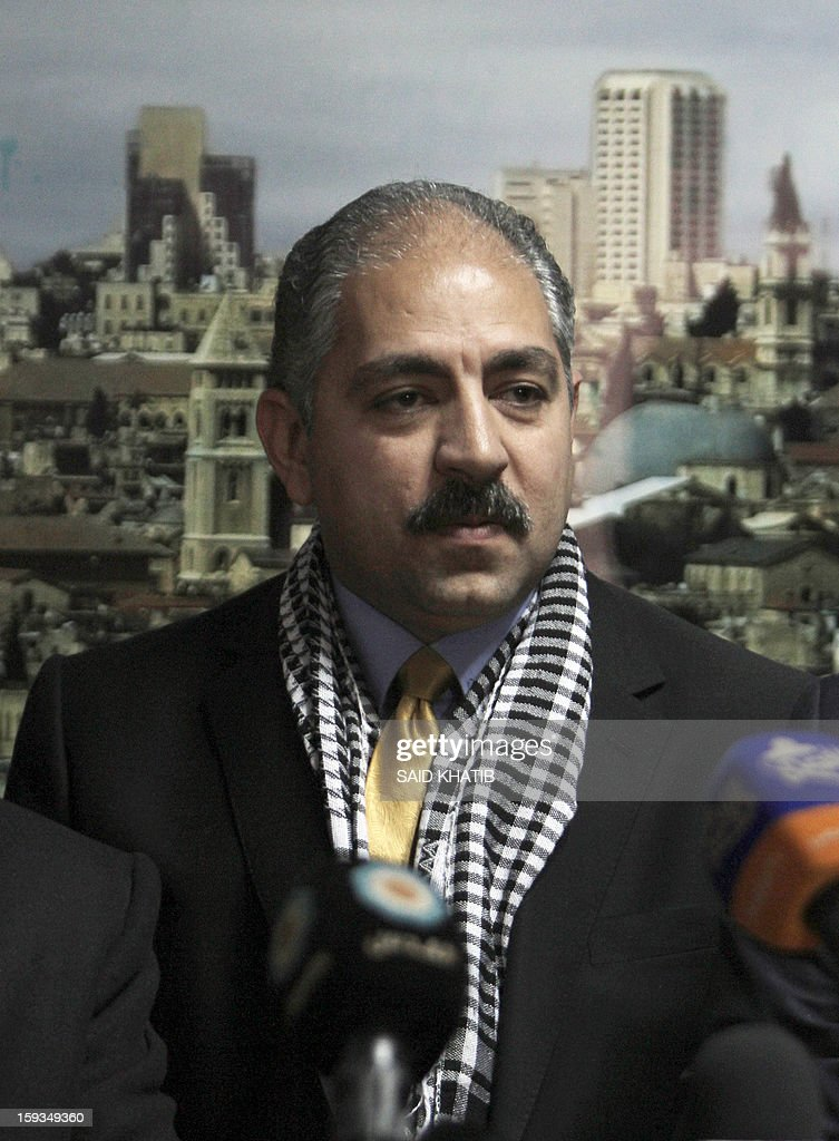 Egyptian Minister of Sports Elamri Faruq speaks to the press as Minister of Youth, Sports and Culture in Gaza Mohammed Almadhun (unseen) listens on, upon his arrival in the southern Gaza Strip town of Rafah through the border with Egypt, on January 12, 2013.