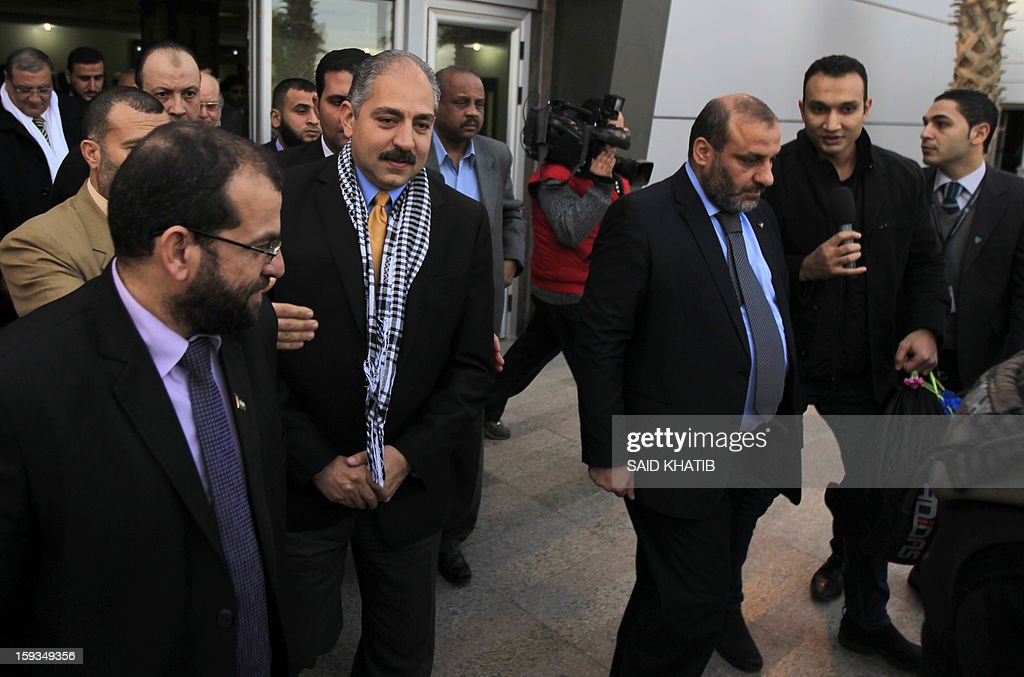 Egyptian Minister of Sports Elamri Faruq (C-L) walks with Minister of Youth, Sports and Culture in Gaza Mohammed Almadhun (R), upon his arrival in the southern Gaza Strip town of Rafah through the border with Egypt, on January 12, 2013.