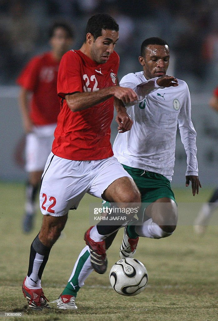 Egyptian Mohammed Abu Trika vies for the ball with Saudi Omar alGhamdi during their final football match at the 11th Pan Arab Games in Cairo 25...