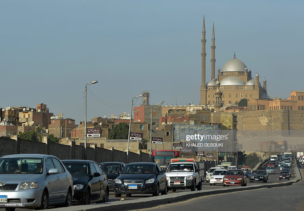 Egyptian motorists drive past the Mohammed Ali mosque in Cairo on March 11, 2013. The political and economic crisis in Egypt has affected the imports of fuel making life miserable for motorists who queue sometimes for hours to buy fuel and crippling business that rely on diesel such as bakers and farmers.