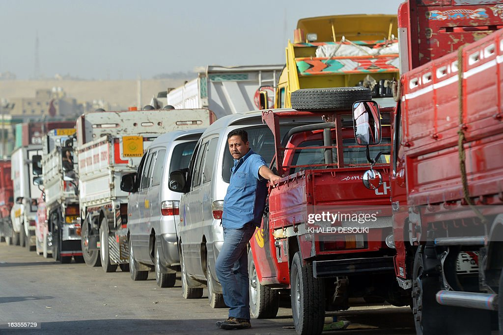 Egyptian motorists line up to buy fuel at a gas station in Cairo on March 11, 2013. The political and economic crisis in Egypt has affected the imports of fuel making life miserable for motorists who queue sometimes for hours to buy fuel and crippling business that rely on diesel such as bakers and farmers.