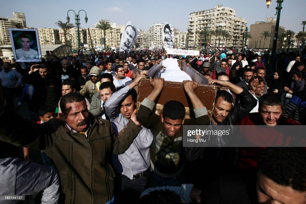 Egyptian mourners carry the coffin of Mohamed Elshafee, who died during violence marking the second anniversary of Egyption uprising and was only recently identified, during his funeral on March 5, 2013 in Cairo, Egypt. Hundreds of protesters attend in the funeral and protest Egypt's President Mohamed Mursi.