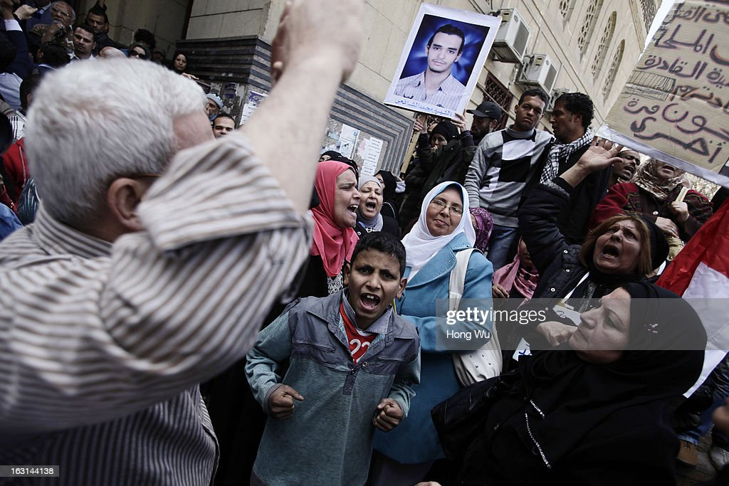 Egyptian mourners chant slogans during the funeral of Mohamed Elshafee, who died during violence marking the second anniversary of Egyption uprising and was only recently identified, on March 5, 2013 in Cairo, Egypt. Hundreds of protesters attend in the funeral and protest Egypt's President Mohamed Mursi.