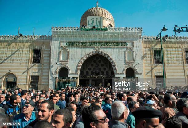 Egyptian mourners gather outside the Sayeda Nafisa mosque as they attend the funeral of the late popular singer and actress Shadia in the capital...