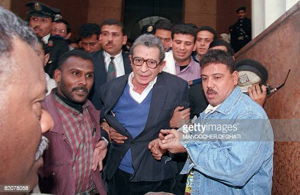 Egyptian movie director Youssef Chahine is escorted out of Cairo on January 25 1995 Chahine did not obtain from the appeal court the lifting of a ban...