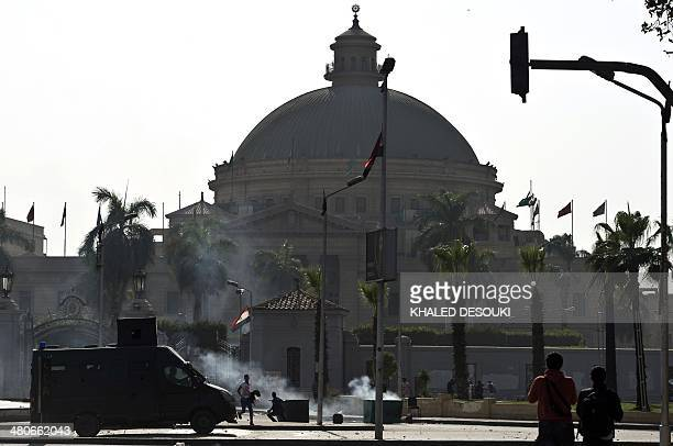 Egyptian Muslim Brotherhood students and supporters of ousted president Mohamed Morsi clash with riot police following a demonstration outside Cairo...