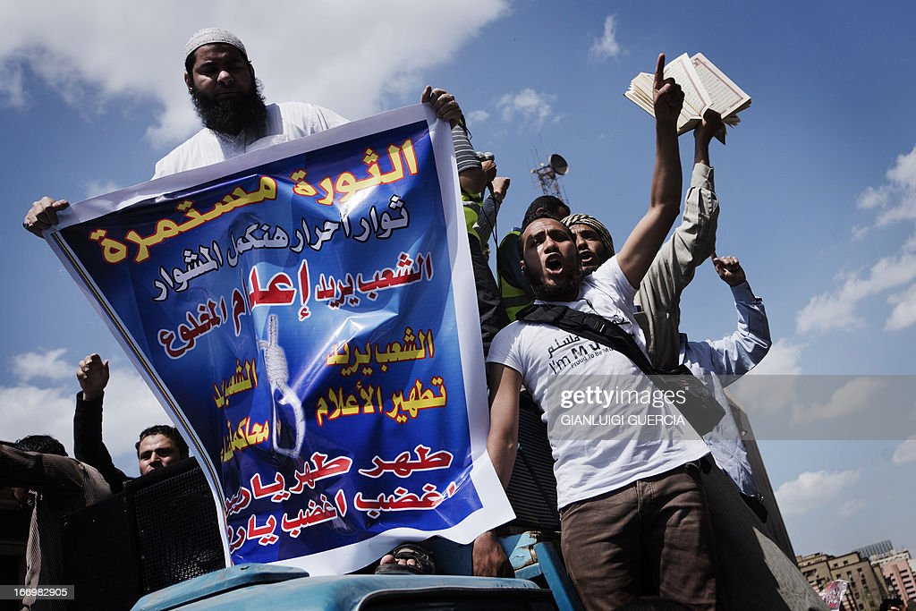 Egyptian Muslim Brotherhood supporters arrive shouting slogans at protest in front of the High Court in Cairo to demand a purge in the Egyptian judicial system on April 19, 2013.