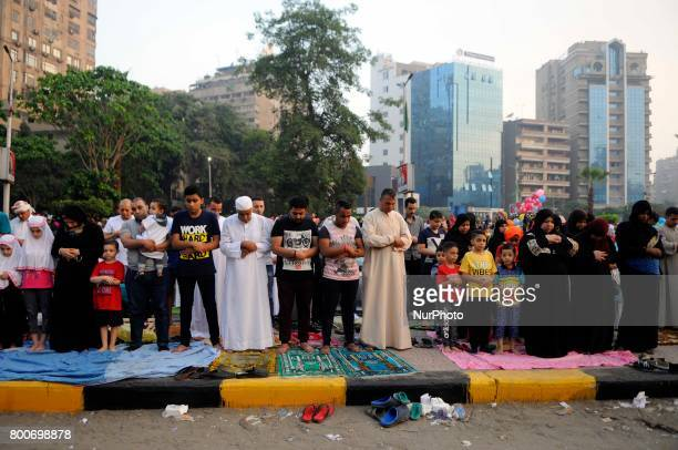 Egyptian Muslim men and women gather for a prayer during the Muslim holiday of Eid alFitr inMostafa Mahmoud Mosque Giza Egypt 25 June 2017 Egyptian...