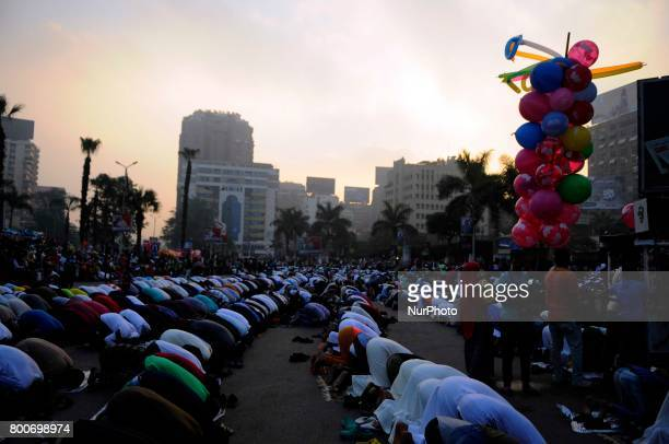 Egyptian Muslim men gather for a prayer during the Muslim holiday of Eid alFitr at Mostafa Mahmoud Mosque Giza Egypt 25 June 2017 Egyptian Muslims...