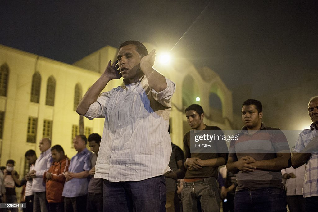 Egyptian muslim protesters pray inside the grounds of the St Mark's Cathedral in the Cairo suburb of Abasseyya during clashes with Egyptian riot police and groups of plain-clothed men outside the grounds on April 7, 2013 in Cairo, Egypt. Clashes began in and around the Cathedral grounds after a funeral procession for two coptic protesters killed during clashes on April 5 was attacked by unknown assailants on Sunday afternoon.