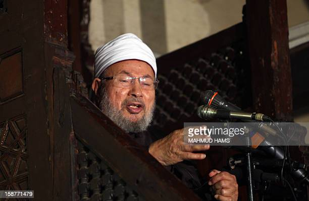 Egyptian Muslim scholar Sheikh Yusuf alQaradawi addresses Muslims at AlAzhar mosque during the weekly Friday prayer in Cairo on December 28 2012...