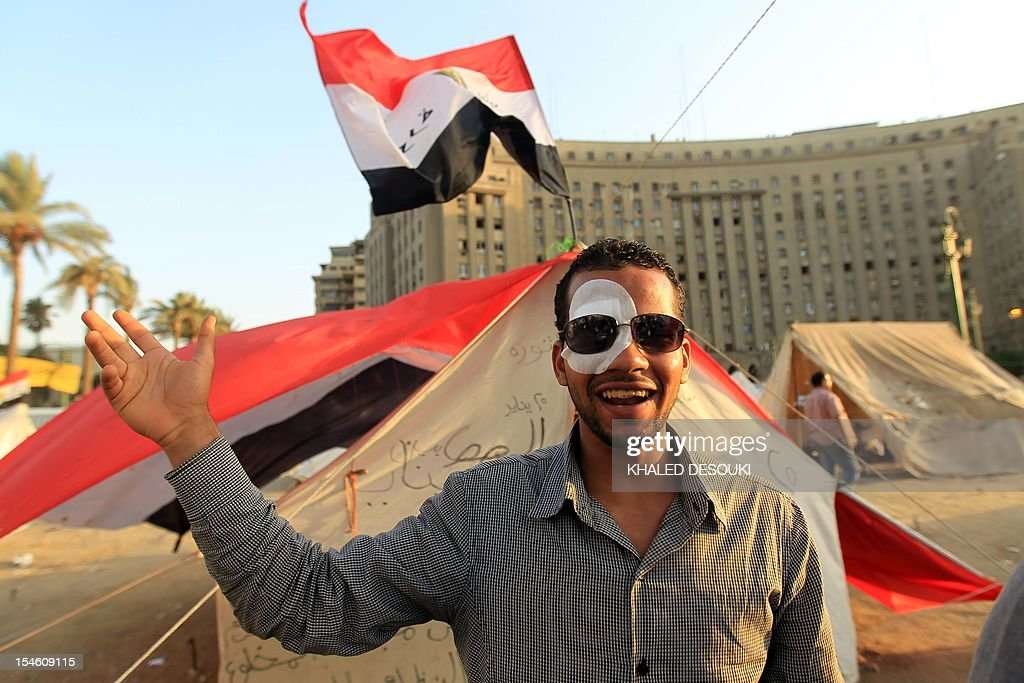 Egyptian Mustafa Sorror 26yearsold who lost his eye in his country's January 28 revolution gestures as he stands outside his tent pitched in Tahrir...