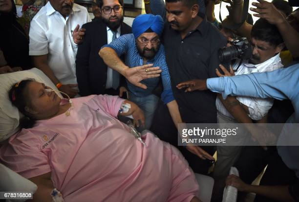Egyptian national Eman Ahmed Abd El Aty is taken on a stretcher towards an ambulance at a hospital in Mumbai on May 4 2017 An Egyptian once believed...