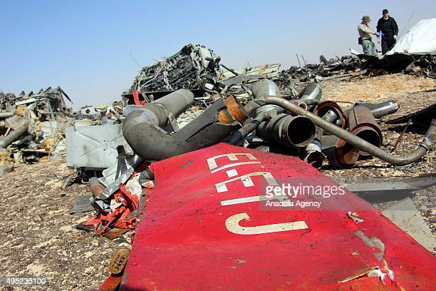 Egyptian officials inspect the crash site of Russian Airliner in Suez Egypt on November 01 2015 A Russian Airbus321 airliner with 224 people aboard...
