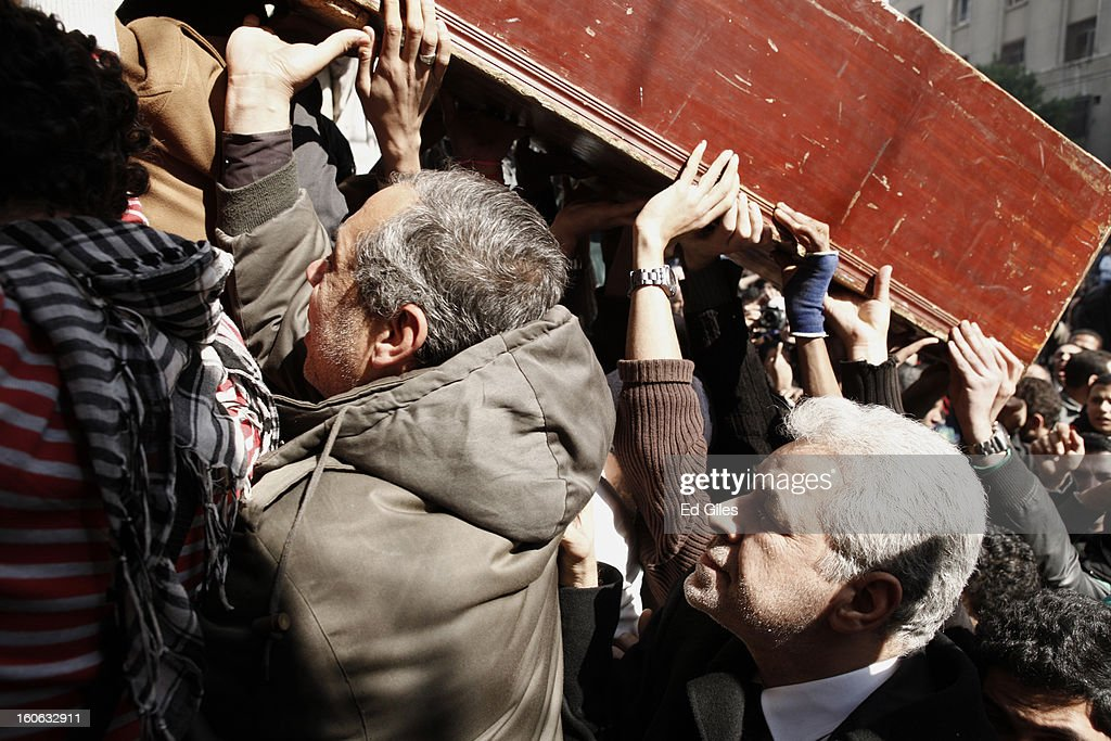 Egyptian opposition figure Hamdeen Sabbahi (R), former Presidential candidate and a leading member of the country's National Salvation Front, stands with pallbearers at a funeral for two protesters killed during violent clashes with Egyptian security forces in the Egyptian capital in previous days, at the Omar Makram Mosque in Tahrir Square, on February 4, 2013 in Cairo, Egypt. The funeral, held for Egyptian protesters Mohammed al Guindy and Amr Saad who were killed during fighting with riot police at protests near Cairo's Tahrir Square and outside Egypt's Presidential Palace, respectively, took place in Cairo's iconic in Tahrir Square. Protests have continued across Egypt nearly more than one week after the second anniversary of the Egyptian Revolution that overthrew former President Hosni Mubarak on January 25, 2011.(Photo by Ed Giles/Getty Images). CAIRO, EGYPT - FEBRUARY 4: Egyptian opposition figure Hamded Sabbahi (R), former Presidential candidate and a leading member of the country's National Salvation Front, stands with pallbearers at a funeral for two protesters killed during violent clashes with Egyptian security forces in the Egyptian capital in previous days, at the Omar Makram Mosque in Tahrir Square, on February 4, 2013 in Cairo, Egypt. The funeral, held for Egyptian protesters Mohammed al Guindy and Amr Saad who were killed during fighting with riot police at protests near Cairo's Tahrir Square and outside Egypt's Presidential Palace. Protests have continued across Egypt nearly more than one week after the second anniversary of the Egyptian Revolution that overthrew former President Hosni Mubarak on January 25, 2011.