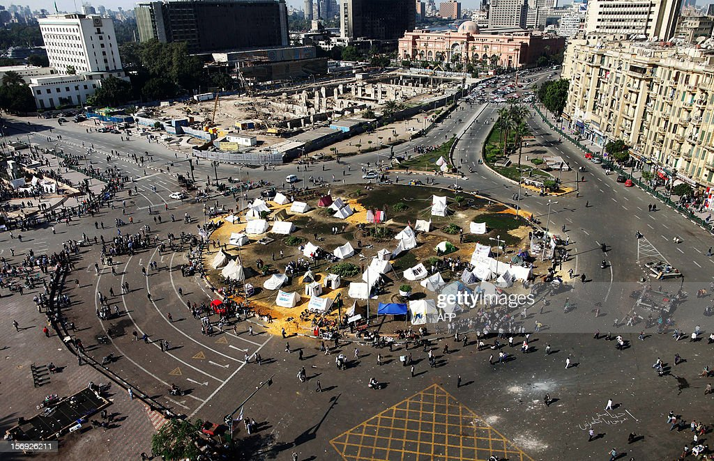 Egyptian opposition gather in sit-in tents at the landmark Tahrir square in Cairo on November 25, 2012. Scuffles broke out between journalist supporters and foes of the Muslim Brotherhood at an emergency union meeting over Islamist President Mohamed Morsi's decree giving him broad powers, a journalist who was there reported.