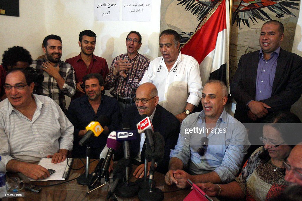 Egyptian opposition leader and Nobel Prize Laureate Mohammed ElBaradei (C) sits among protester during a visit to the ongoing sit-in at the Egyptian Ministry of Art and Culture on June 16, 2013 in Cairo. Tensions began earlier this month after new minister Alaa Abdel Aziz sacked several arts chiefs, including the heads of the Opera House, the Fine Arts department, the General Egyptian Book Organisation and the National Archives.