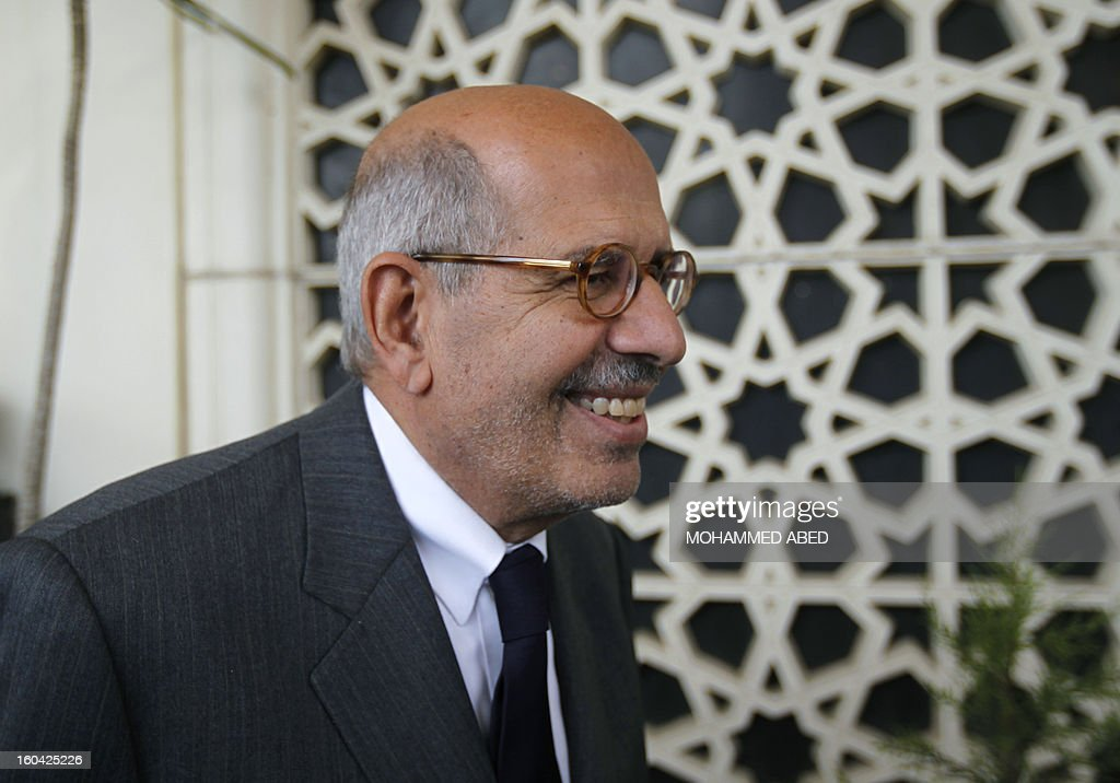 Egyptian opposition leader and Nobel Prize Laureate Mohammed el-Baradei smiles after giving a press conference alongside other Egyptian leaders in Cairo on January 31, 2013. Rival factions in Egypt condemned the violence which has killed dozens in a week of unrest and pledged support for a national dialogue to resolve the political crisis gripping the country. AFP PHOTO/MOHAMMED ABED
