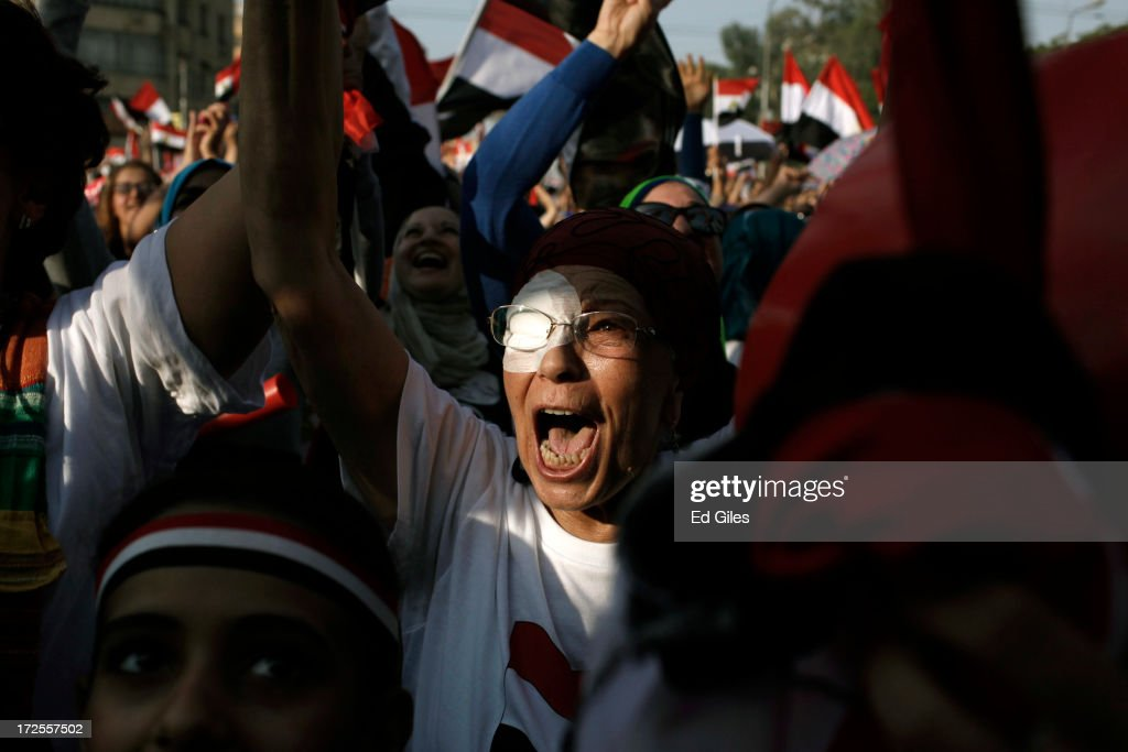 Egyptian opposition protesters celebrate as news is announced of Egyptian President Mohammed Morsi proposing a consensus government as a way out of the country's political crisis, at Egypt's Presidential Palace on July 3, 2013 in Cairo, Egypt. As the Egyptian Army's deadline passed on Wednesday afternoon, President Morsi proposed a consensus government as a way out of the country's political deadlock between the military and Muslim Brotherhood. As unrest spreads throughout the country, at least 23 people were killed in Cairo on Tuesday and over 200 others were injured. It has been reported that the military has taken over state television.