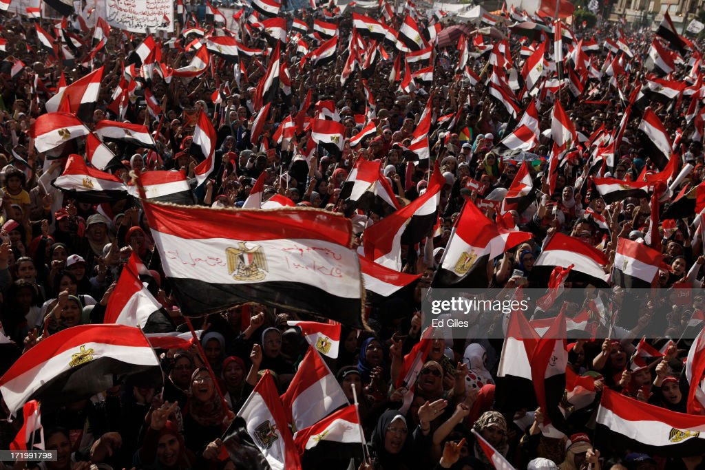 Egyptian opposition protesters chant during a demonstration in Tahrir Square as part of the 'Tamarod' campaign on June 30, 2013 in Cairo, Egypt. Crowds of pro- and anti-Morsi protesters gathered in locations across Egypt on June 30, the day of a series of nation-wide mass demonstrations entitled 'Tamarod', or 'Rebel', planned to take place on the first anniversary of Morsi's election to the Egyptian Presidency. The 'Tamarod' campaign, organised by a coalition of opposition political groups, aims to bring down the government of President Morsi through country-wide demonstrations. (Photo by Ed Giles/Getty Images).