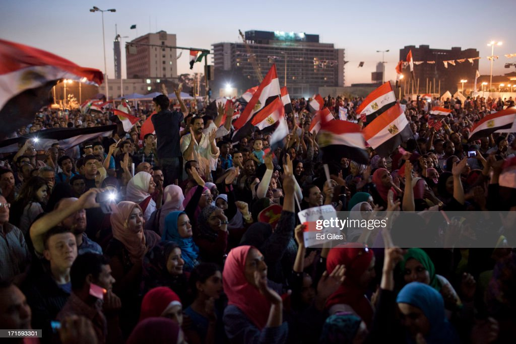 Egyptian opposition protesters gather in Tahrir Square during a demonstration against President Mohamed Morsi, prior to a televised national address by Morsi on June 26, 2013 in Cairo, Egypt. Protesters gathered in central Cairo's iconic Tahrir Square to watch a live speech by President Morsi just days prior to a series of planned nation-wide protests on June 30, the first anniversary of Morsi's election to the Egyptian Presidency. The 'Tamarod' or 'rebel' protests, organised by a coalition of opposition political groups, aim to bringing down the government of President Mohamed Morsi through country-wide protests.