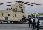 Egyptian paramedics load the corpses of Russian victims of a Russian passenger plane crash in the Sinai Peninsula into a military aircraft at Kabret...