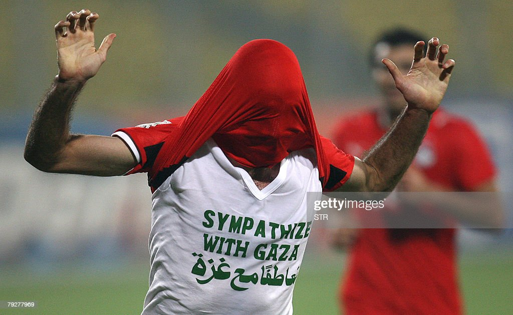 Egyptian player Mohamed Abou Traika wears a tee shirt reading 'Sympathize with Gaza' as he celebrates his goal 10 against Sudan in Kumasi 26 January...