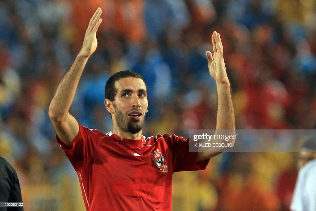 Egyptian player Mohammed Abou Trika of alAhli club celebratex scoring the winning goal against Haras alHodud club during their Super Cup match in...