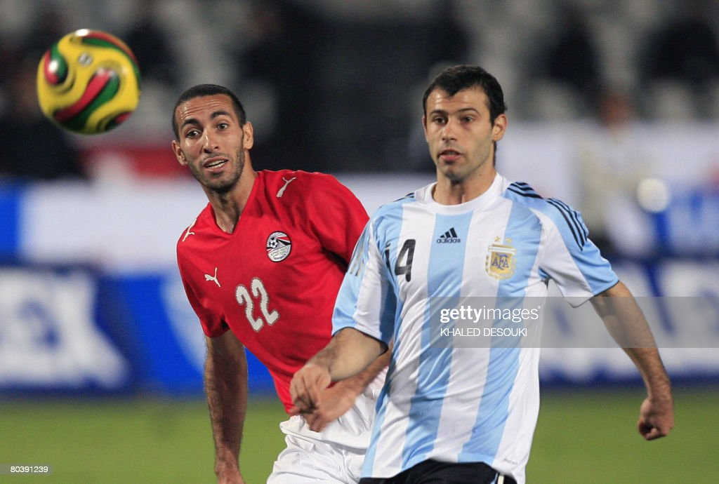 Egyptian player Mohammed Abou Trika vies for the ball with Javier Mascherano of Argentina during their friendly football match in Cairo on March 26...