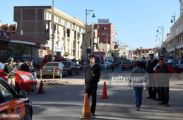 Egyptian police and security stand guard outside the Bella Vista Hotel in Egypt's Red Sea resort of Hurghada on January 9 the day after the hotel...