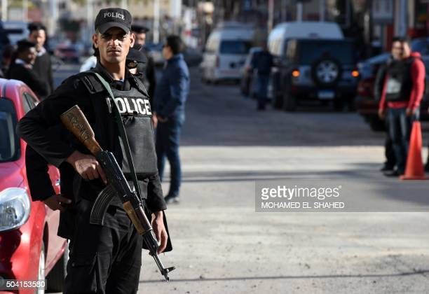 Egyptian police and security stands guard outside the Bella Vista Hotel in Egypt's Red Sea resort of Hurghada on January 9 the day after the hotel...