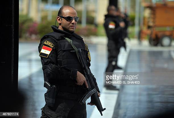 Egyptian police stand guard as ministers and attendees arrive for the Arab foreign ministers conference in the Egyptian Red Sea resort of Sharm...