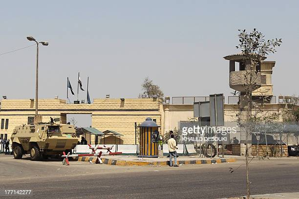 Egyptian policemen and soldiers stand guard outside the prison of Tora where Alaa and Gamal Mubarak the sons of former Egyptian president Hosni...
