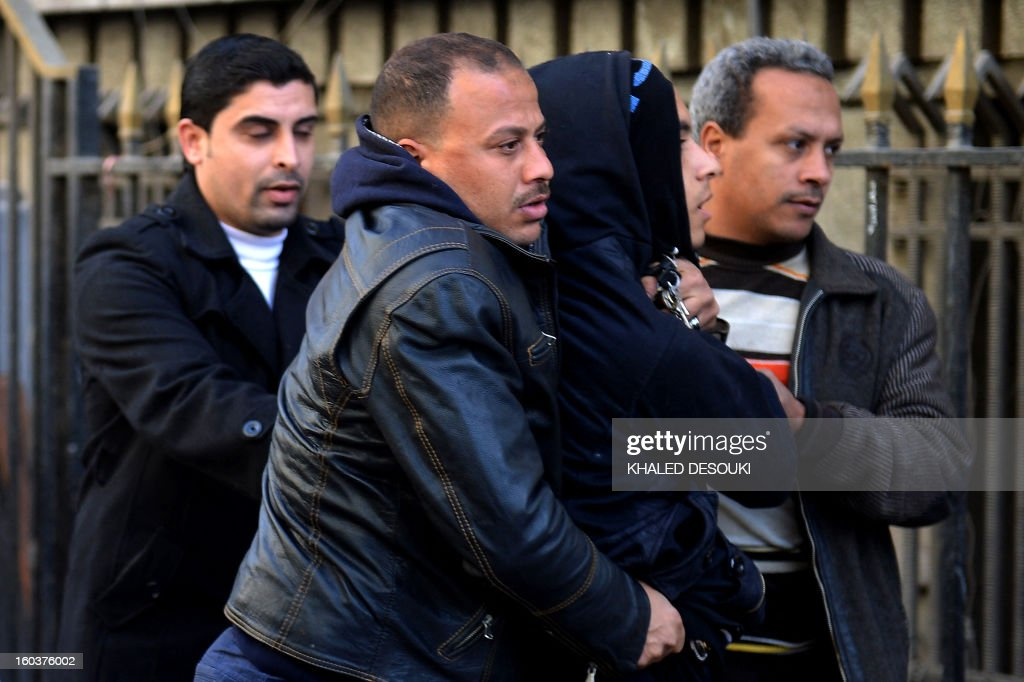 Egyptian policemen in plainclothes detain a youth (2nd-R) suspected of being a member of the 'Black Bloc' group during a demonstration outside the high court in central Cairo on January 30, 2013. Egyptian authorities detained suspected 'Black Bloc' members as they protested an order by the public prosecutor to arrest anyone from the shadowy opposition group, an AFP journalist said. Presenting themselves as the defenders of protesters opposed to President Mohamed Morsi's rule, the Black Bloc reportedly models itself on anarchist groups of the same name in Europe and the United States.