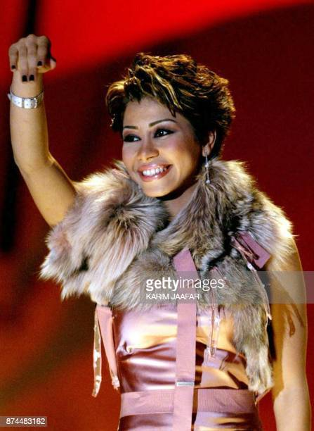 Egyptian pop star Sherine Abdel Wahab performs 02 February 2004 in Doha on the opening night of Qatar's Fifth Song Festival The fiveday annual...