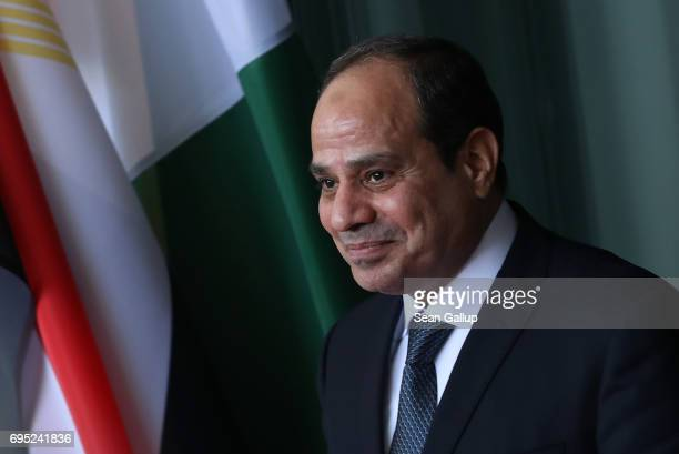 Egyptian President Abd ElFattah ElSisi departs following talks with German Chancellor Angela Merkel at the Chancellery on June 12 2017 in Berlin...