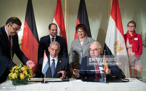 Egyptian President Abdel Fattah alSisi and German Economy and Energy Minister Brigitte Zypries look on as Egypt's Minister of Trade and Industry of...