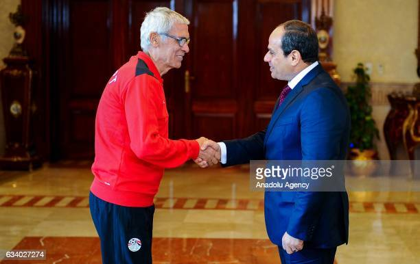 Egyptian President Abdel Fattah alSisi and Head coach of Egyptian National team Hector Cuper during a welcoming ceremony held for national team...