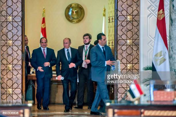 Egyptian President Abdel Fattah alSisi and his Russian counterpart Vladimir Putin prepare to give a press conference following their talks at the...