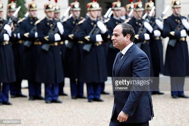 Egyptian President Abdel Fattah alSisi arrives at the Elysee presidential palace for a meeting with French President Francois Hollande on November 26...