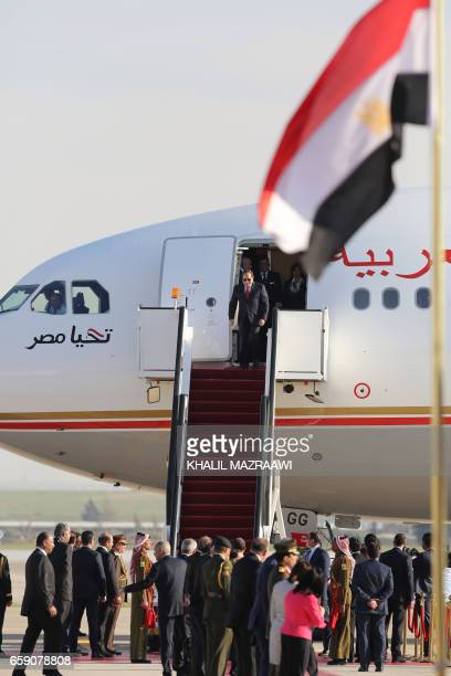 Egyptian President Abdel Fattah alSisi arrives latter at the Queen Alia International Airport in Amman on March 28 2017 ahead of talks on the eve of...