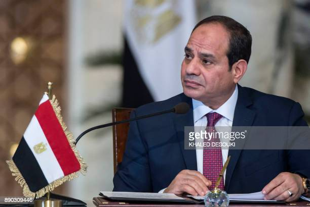 Egyptian President Abdel Fattah alSisi attends a press conference with his Russian counterpart following their talks at the presidential palace in...