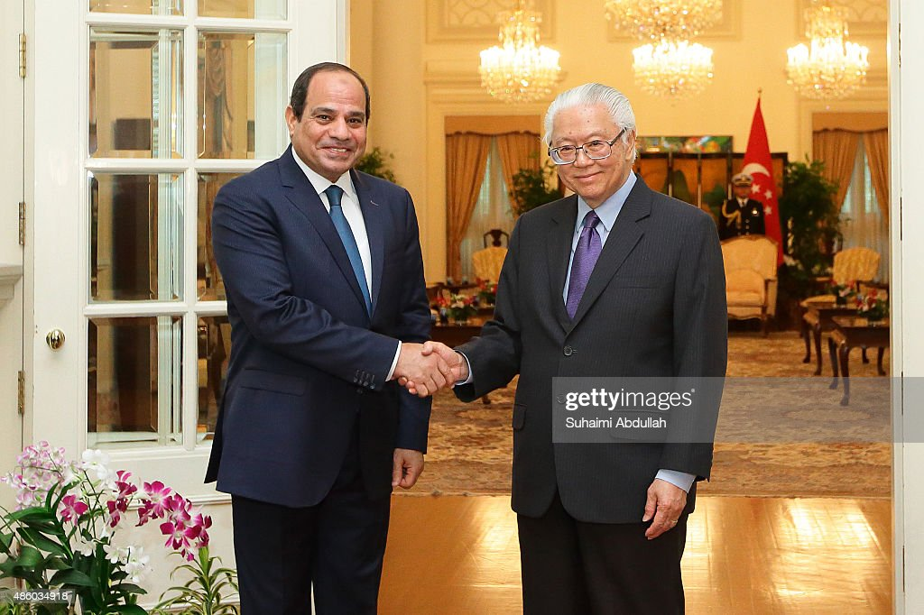 Egyptian President, Abdel Fattah Al-Sisi (L) calls on Singapore President, <a gi-track='captionPersonalityLinkClicked' href=/galleries/search?phrase=Tony+Tan+Keng+Yam&family=editorial&specificpeople=6629941 ng-click='$event.stopPropagation()'>Tony Tan Keng Yam</a> at the Istana on August 31, 2015 in Singapore. The visit to Singapore of Egyptian President of Abdel Fattah Al-Sisi marks the first presidential visit between the two nations. Al-Sisi will visit Indonesia and China during his Asian tour.