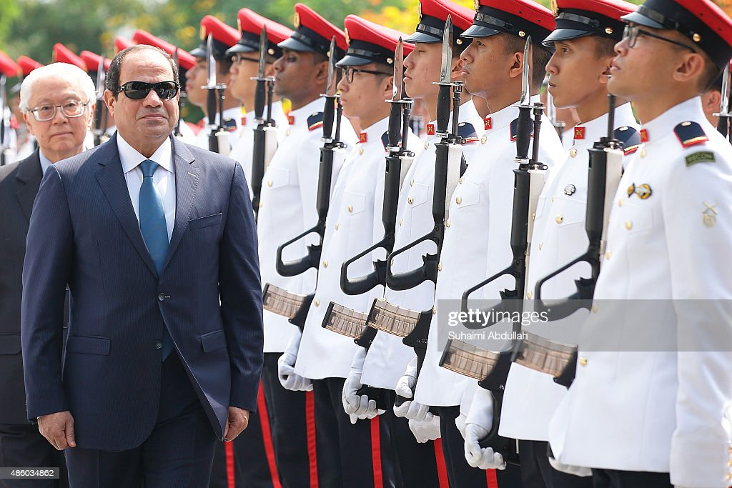 Egyptian President, Abdel Fattah Al-Sisi (L) inspects the guard of honour during the official welcome ceremony accompanied by Singapore President, <a gi-track='captionPersonalityLinkClicked' href=/galleries/search?phrase=Tony+Tan+Keng+Yam&family=editorial&specificpeople=6629941 ng-click='$event.stopPropagation()'>Tony Tan Keng Yam</a> (L, back) at the Istana on August 31, 2015 in Singapore. The visit to Singapore of Egyptian President of Abdel Fattah Al-Sisi marks the first presidential visit between the two nations. Al-Sisi will visit Indonesia and China during his Asian tour.