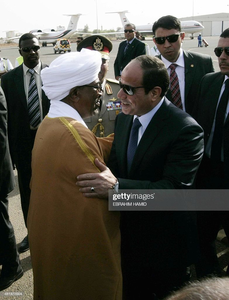 Egyptian President Abdel Fattah alSisi is welcomed by Sudanese President Omar alBashir upon his arrival at Khartoum airport for an official visit on...