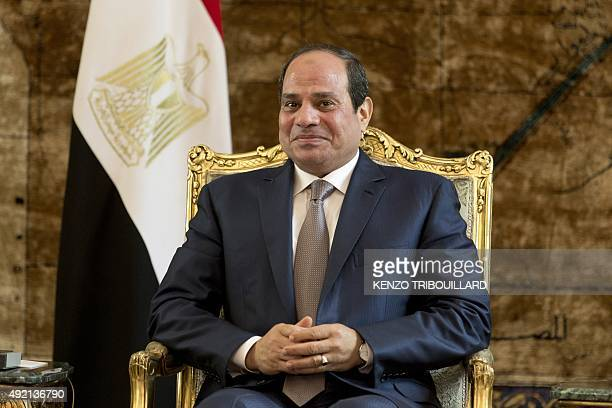 Egyptian President Abdel Fattah alSisi poses during a meeting with French Prime Minister Manuel Valls at the presidential palace on October 10 2015...